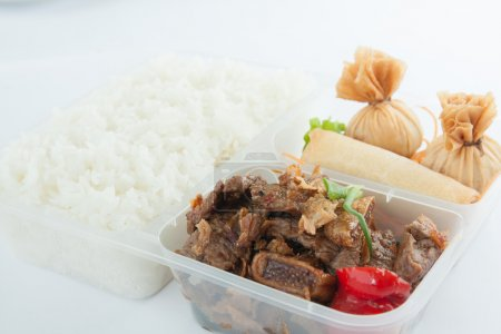 Thai take away food, garlic beef and appitizer with rice