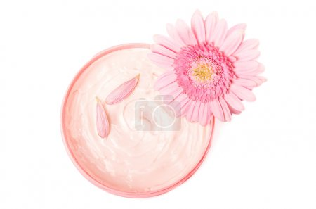 Photo for Closeup of open jar of body butter with beautiful pink gerbera - Royalty Free Image