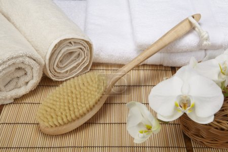 Wellness - Bath brush, rolled towels and orchids