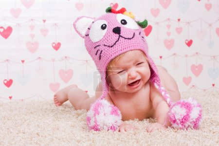 Crying baby with hat