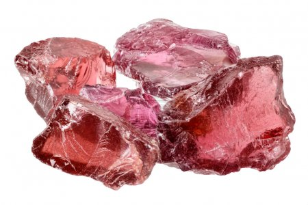 A pile of purple red rhodolite garnet gemstone cry...