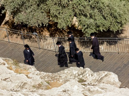 Jews in national clothes go to the gates of the King David in Jerusalem