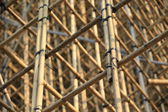 Thousands of bamboo which is the Scaffolding project in office building construction site in hong kong downtown