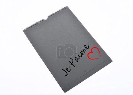 Photo pour Bloc note gris avec ecrit je t'aime et un cœur - image libre de droit