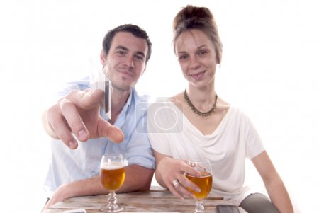 Photo for Young couple pays the bill with a credit card - Royalty Free Image