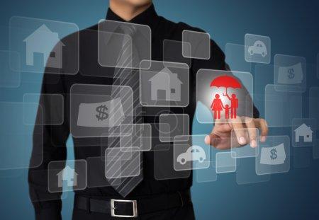 Businessman pressing insurance button on virtual screens