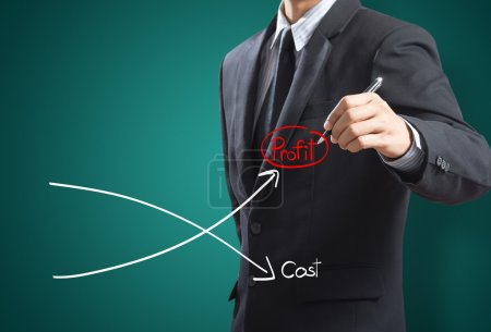 Business man drawing graph of profit compare with ...