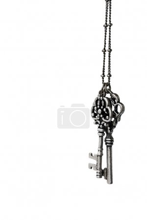 Ancient keys on a chain isolated on a white background