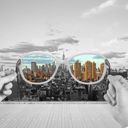 Photo for Hand holding glasses looking to modern skyscraper - Royalty Free Image