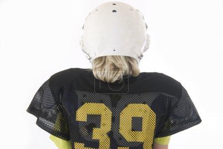 Photo for Boy long blonde hair American Football helmet - Royalty Free Image