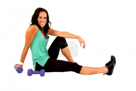 Woman during break from working out with barbells