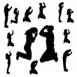 Vector silhouette of people who pray on a white ba...