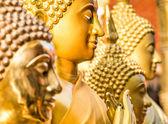 Detail of golden Buddha Statues