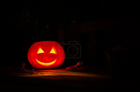 Halloween Pumpkin Lantern on a dark Background