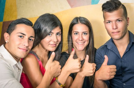 Happy group of friends with thumbs up