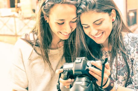Photo for Young girls watching photos in a digital Camera - Royalty Free Image