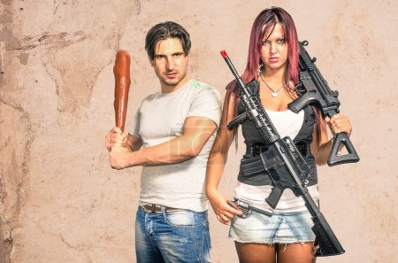 Primitive man and modern woman with weapons - Funn...