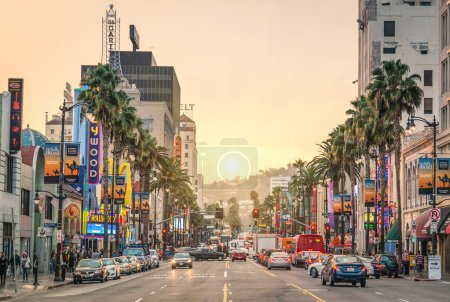 LOS ANGELES - DECEMBER 18, 2013: View of Hollywood Boulevard at sunset. In 1958, the Hollywood Walk of Fame was created on this street as a tribute to artists working in the entertainment industry.