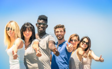 Group of multiracial happy friends with thumbs up - Concept of international friendship and success against racism and multiethnic social barriers
