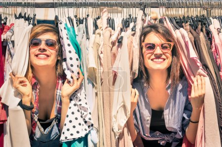 Photo for Young beautiful women at the weekly cloth market - Best friends sharing free time having fun and shopping in the old town in a sunny day - Girlfriends enjoying everyday life moments - Royalty Free Image
