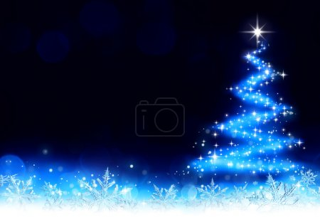 Photo for Christmas background with a trail of stardust and snowflakes that draws a tree - Royalty Free Image