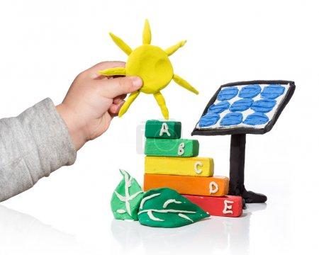 Foto de Nueva generación que piensa de la fotovoltaica - aislado - Imagen libre de derechos