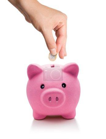 Saving concept - euro coin in piggy bank