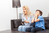 Mother and son playing a video game