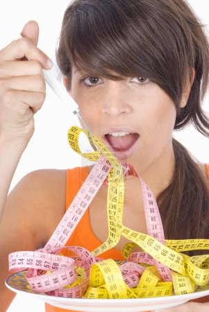 Woman diet eating a tape measures