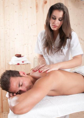 Photo for Woman giving a massage to a young man - Royalty Free Image