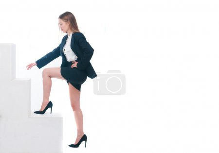 Photo for Successful business woman stepping up on stairs - Royalty Free Image