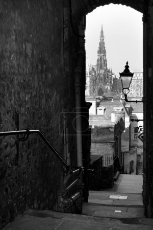Photo for Royal mile lane view of Scott monument, Edinburgh, Scotland. One of Edinburgh's many famous alleyways, Advocate's Close - Royalty Free Image