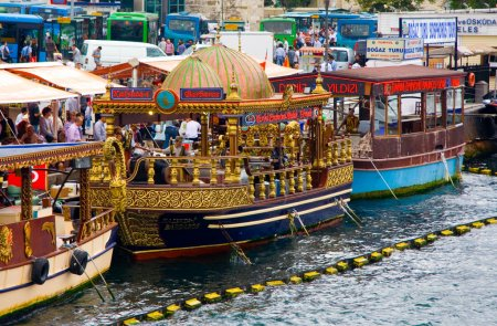Photo for ISTANBUL, TURKEY - SEPT 2009: Touristicr fish sandwich buffet on the water near Galata bridge circa Sept 2009 in Istanbul, Turkey. Bordered on 3 sides by seas, Turkey is a nation of water - Royalty Free Image