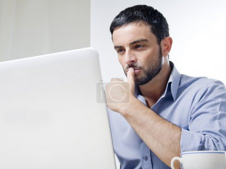 Photo for Young Man with Beard Working on Laptop isolated on a White Background - Royalty Free Image
