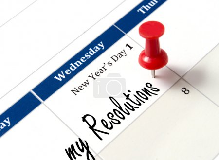 Photo for Pin on calendar pointing new year resolutions close up - Royalty Free Image