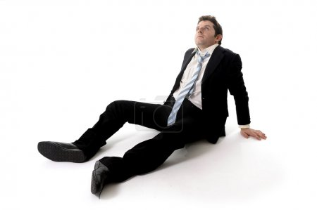 Young Business Man in Stress on the floor