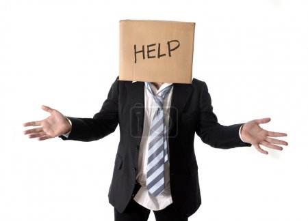 Photo for Business man asking for help with carboard box on his head isolated on white background - Royalty Free Image