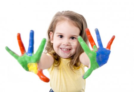 Happy little girl with hands painted in vivid colours