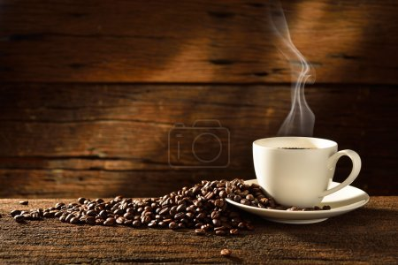 Photo for Coffee cup and coffee beans on old wooden background - Royalty Free Image