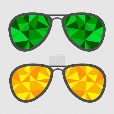 Set of glasses with green and yellow abstract triangles.