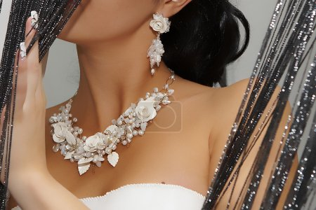 White jewelry on a beautiful bride's neck