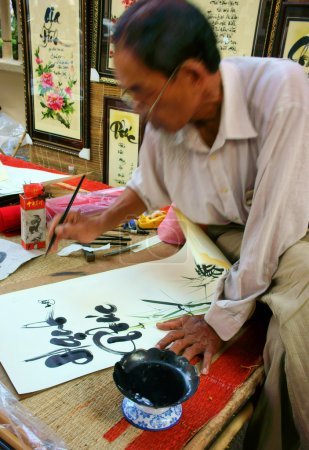 People writing chinese calligraphy