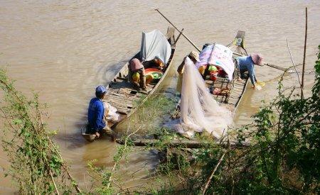 Families of fisherman do fishing on rive