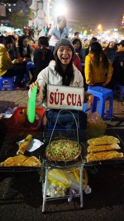 Funny of Vietnamese street food vendor at night outdoor market
