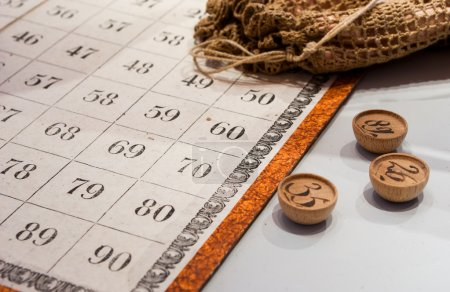 Ancient Italian bingo game board with numbered...
