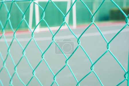 Green coloured chain link fencing
