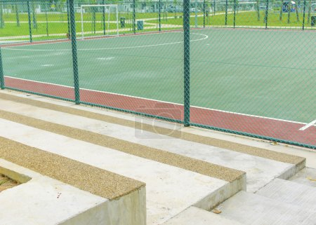 Concrete bench for spectators at futsal court.