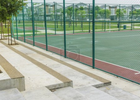 Concrete bench for spectators at futsal court.