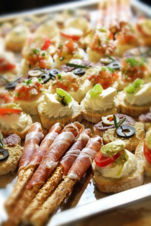 Photo for Variety of finger food on catering event. Shalloe focus - Royalty Free Image