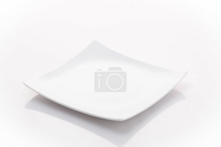 Photo for One empty square plate isolated on a white background - Royalty Free Image